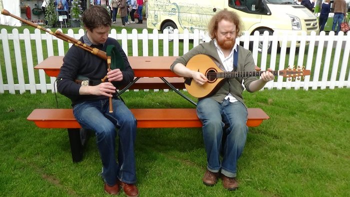 Steve and Fin Moore tuning up ootside oor Story Tent at Gardening Scotland