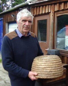 Bee-keeper fae Aboyne Ian Smith wi his skep