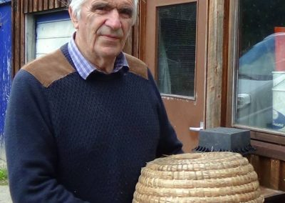 Bee-keeper fae Aboyne Ian Smith wi his skep