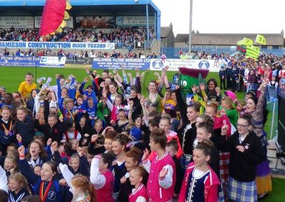 Episode 7 - arrival o the Queen's Baton intae Balmoor Fitba arena in Peterheed
